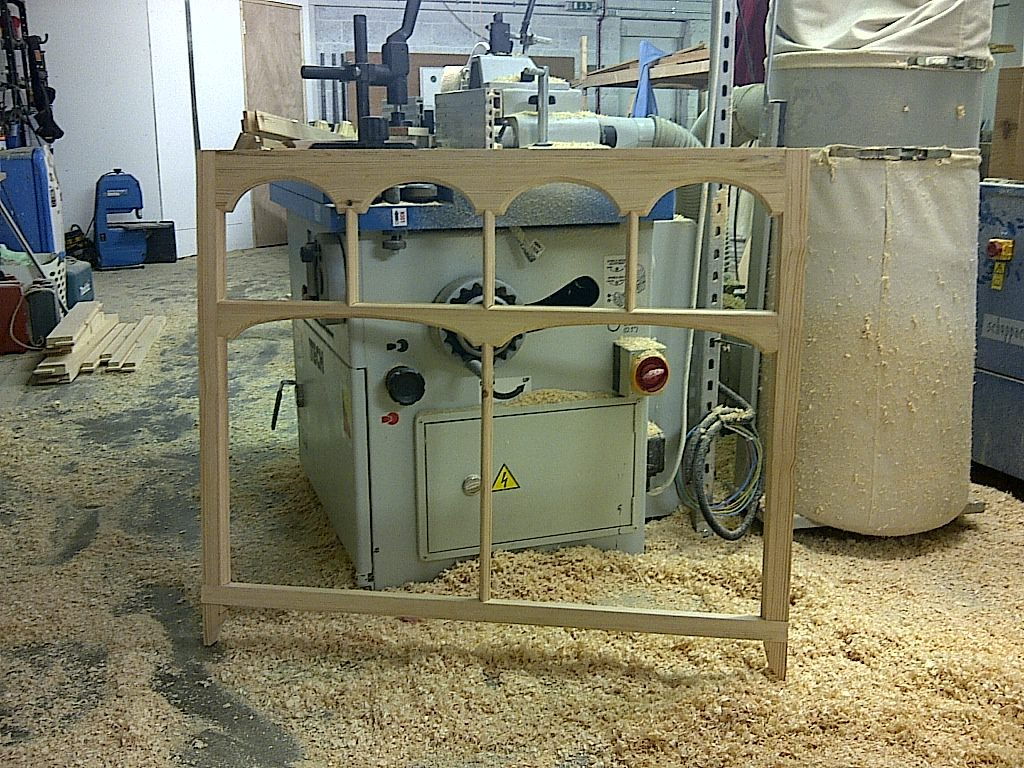 A sash window frame being made